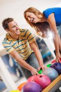 stock-photo-22310033-beautiful-cheerful-couple-bowling